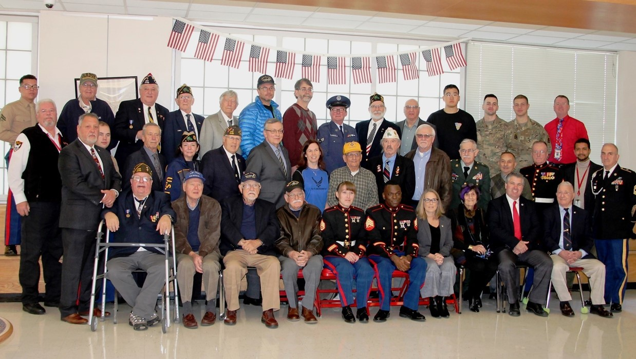 Veterans who visited BHS gathered in the lobby for a photo.  Included in the front row are honored guests Superintendent Hernandez and US Rep. Rosa DiLauro.