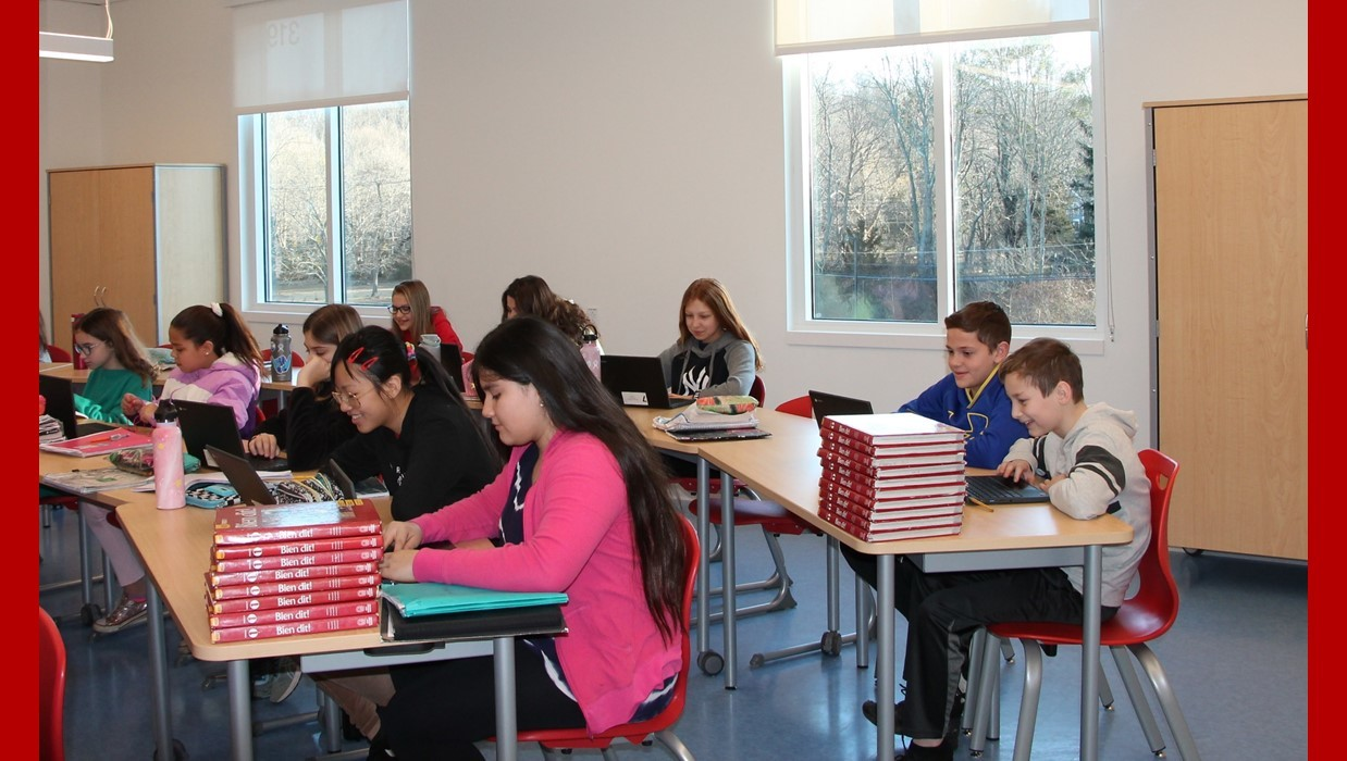 Students studying in a classroom in the new Walsh building