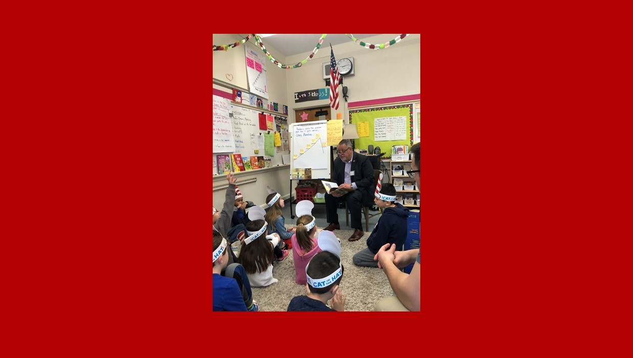 Superintendent reading to classroom