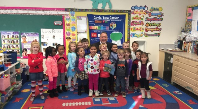 Superintendent with group of  pre-schooler's